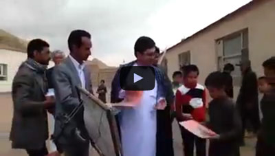 Mr. Hosseini and Governor of Bamyan province distributing books, YouTube video