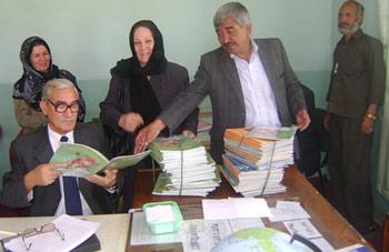 Afghan teachers reviewing Hoopoe Books